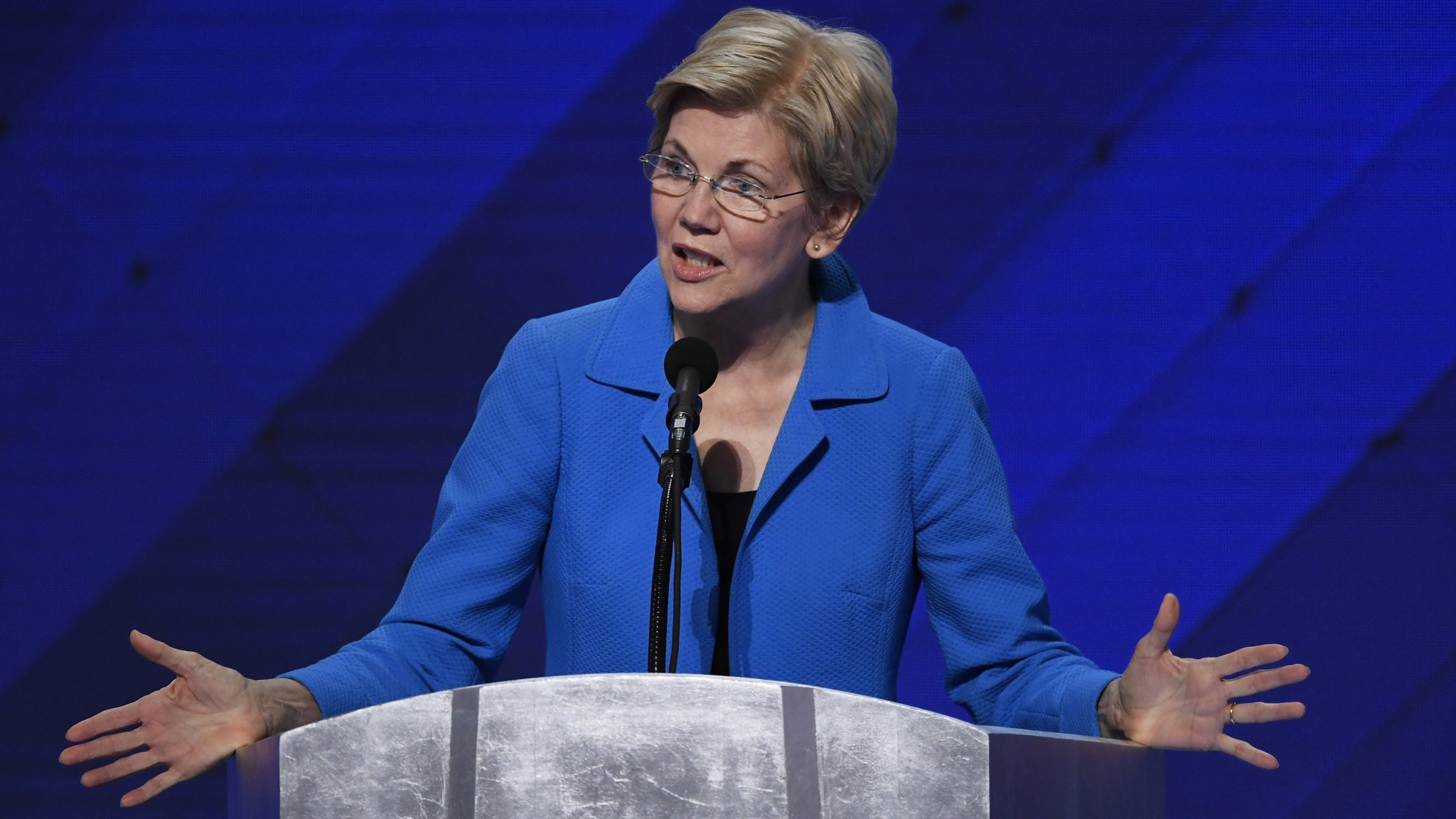 Senator Elizabeth Warren, a Democrat from Massachusetts, speaks during the Democratic National Convention (DNC) in Philadelphia, Pennsylvania, U.S., on Thursday, July 28, 2016. Division among Democrats has been overcome through speeches from two presidents, another first lady and a vice-president, who raised the stakes for their candidate by warning that her opponent posed an unprecedented threat to American diplomacy. Photographer: David Paul Morris/Bloomberg