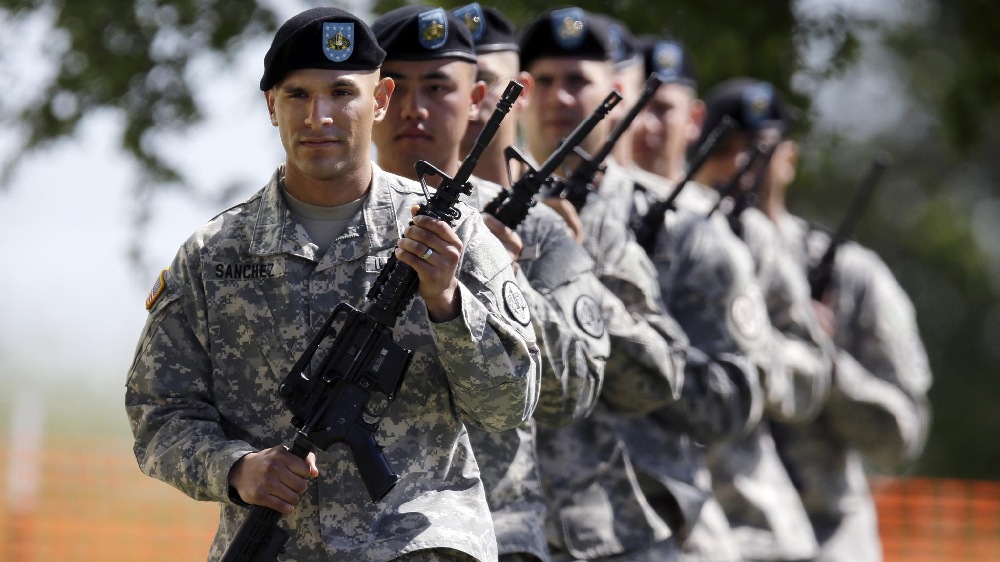 Soldiers prepare for a service for the four killed and more than dozen injured in last week's shooting rampage at Fort Hood, Texas, Wednesday, April 9, 2014, at Fort Hood. President Barack Obama will attend the ceremony. (AP Photo/Eric Gay)
