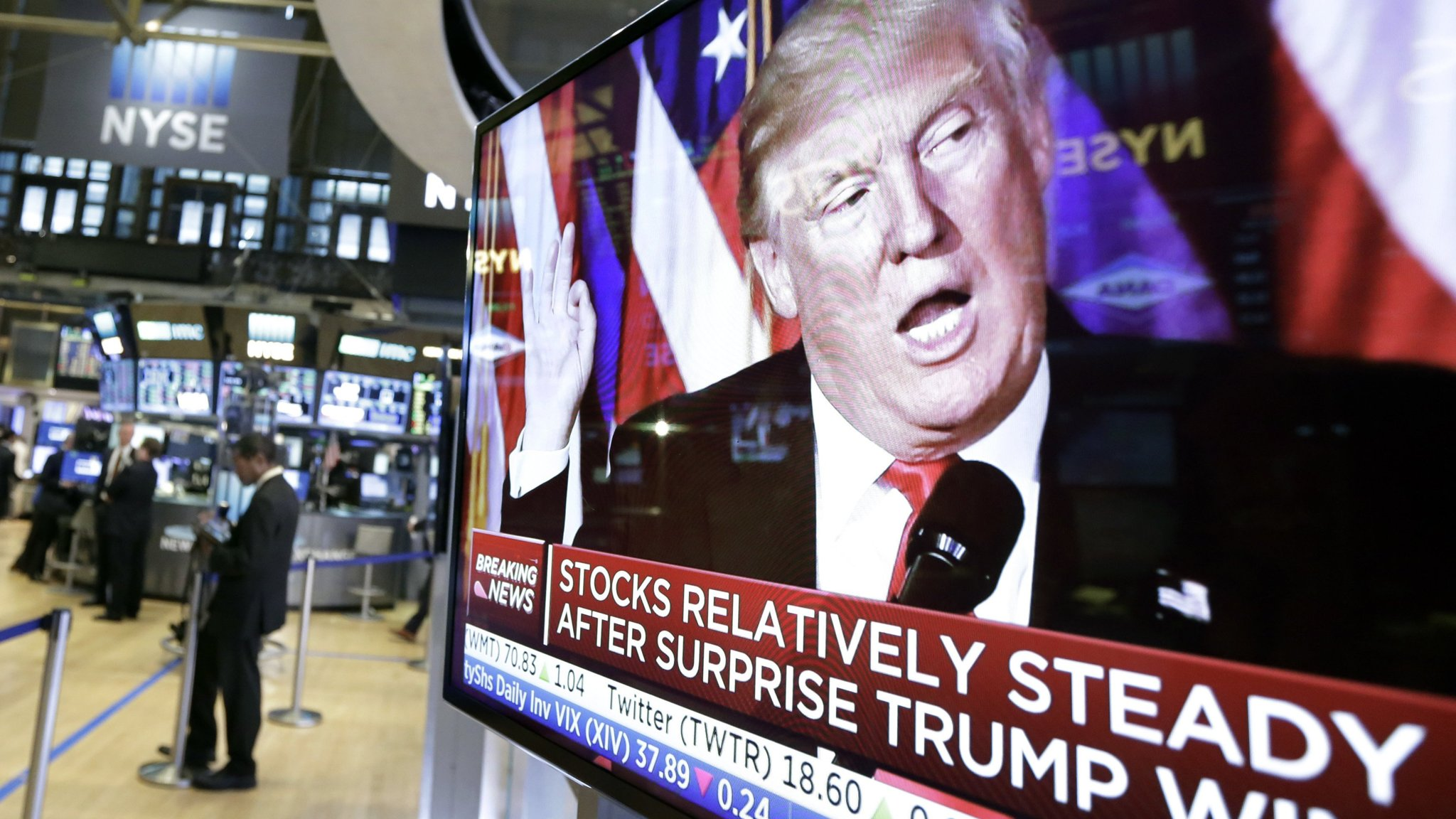 An image of President-elect Donald Trump appears on a television screen on the floor of the New York Stock Exchange (AP Photo/Richard Drew)